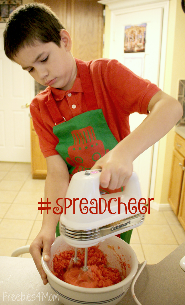 Mixing ingredients for Poinsetta Cookies to #SpreadCheer